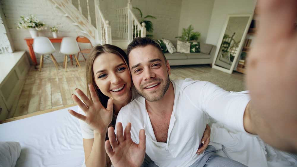 couple waving on video chat