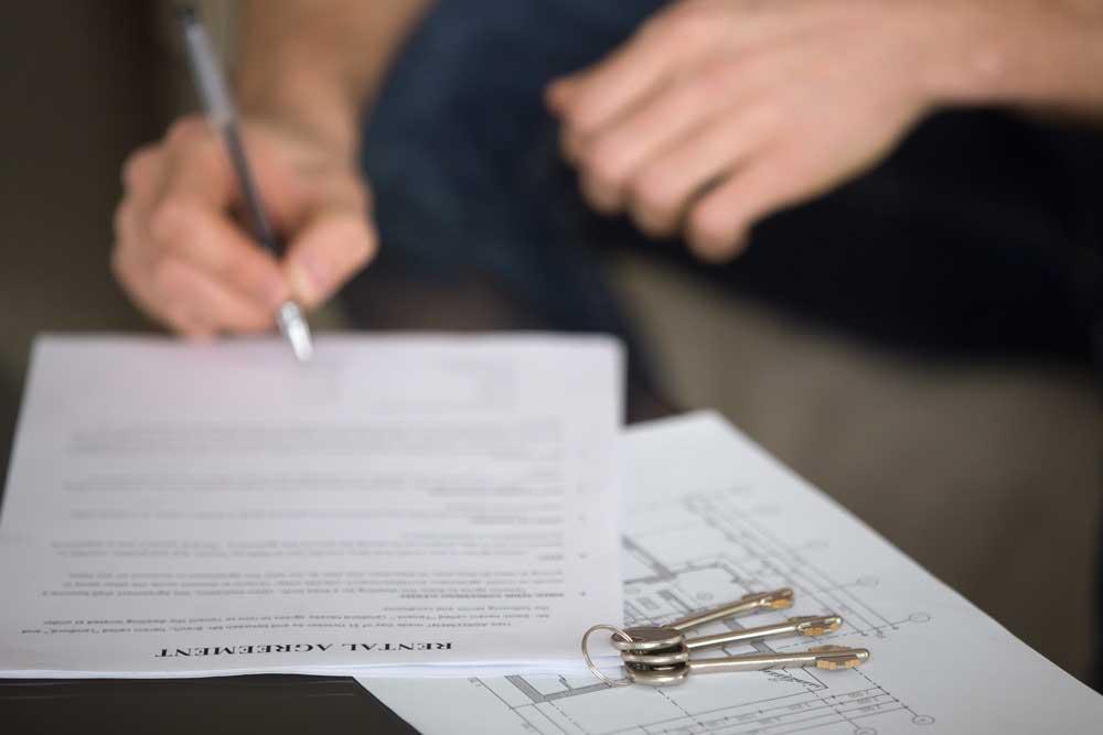 Person signing storage rental agreement