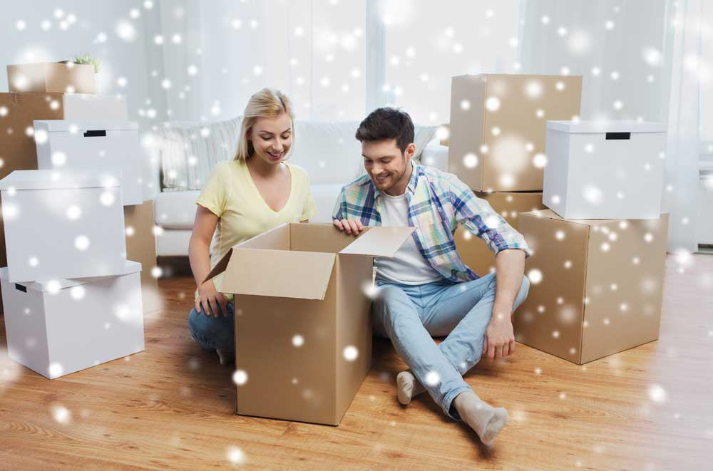 couple taking out items in their new home